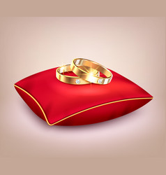 Wedding rings on red ceremonial pillow vector