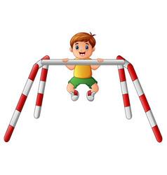 little boy doing pull ups vector image