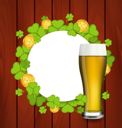 Greeting card with glass of light beer shamrocks vector image