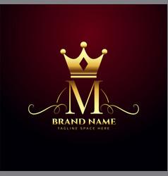 Letter m monogram logo with golden crown design vector