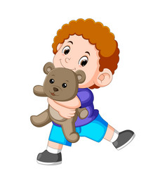 a boy happy play with the grey teddy bear vector image