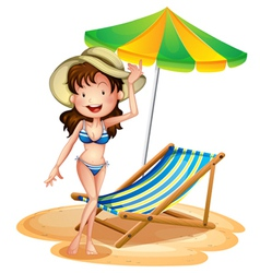 A girl near a foldable beach bed and umbrella vector image