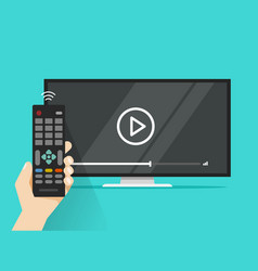 remote control in hand near flat screen tv vector image