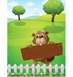 A beaver with an empty wooden board vector image vector image