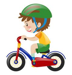 Boy with green helmet riding bike vector