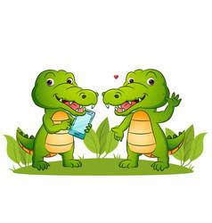 Couple happy crocodile is holding a smart vector