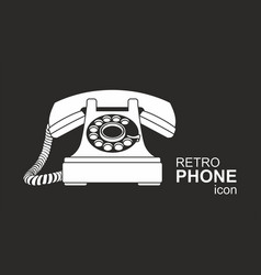 white vintage telephone isolated on black vector image
