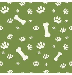 Background with dog paw print and bone on green vector image vector image