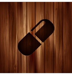 Medical pills icon Wooden background vector image