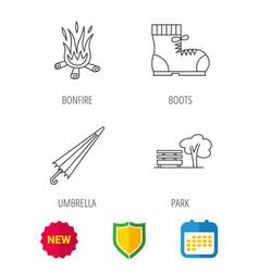 bonfire umbrella and hiking boots icons vector image vector image