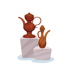 two brown ceramic jugs with lids handles and long vector image