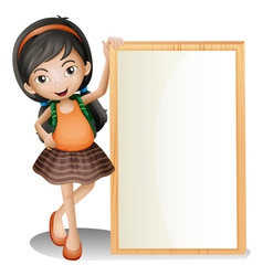 A young lady beside an empty signboard vector image