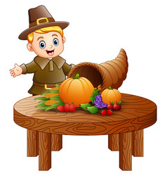 Pilgrim boy with cornucopia fruits and vegetable vector