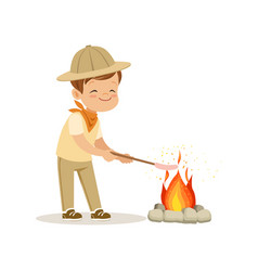 Cute little boy in scout costume frying his vector