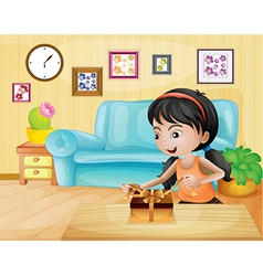 A lady opening her gift in the living room vector image
