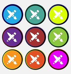Brush Icon sign Nine multi colored round buttons vector