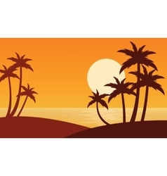 Silhouette of two clum palm on seaside vector