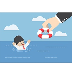 Drowning businessman getting lifebuoy from hand vector image