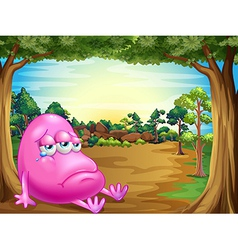 A forest with a sad fat beanie monster vector image