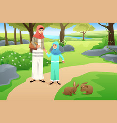 Muslim girl and her mother walking in a park vector