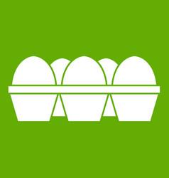 Eggs in carton package icon green vector