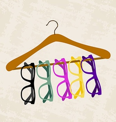 hipster glasses on a hanger for clothes vector image vector image