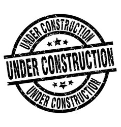 under construction round grunge black stamp vector image