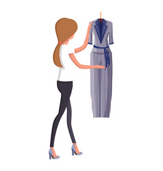 Woman choosing new summer vogue suit with trousers vector