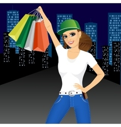 Woman holding shopping bags vector