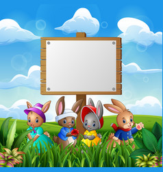 cute bunnies with easter background and blank sign vector image