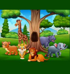 wild animals under hollow tree landscape vector image