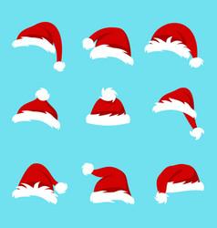 set santa hats isolated on blue background vector image
