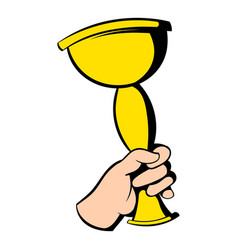Hand holding winner trophy cup icon icon cartoon vector