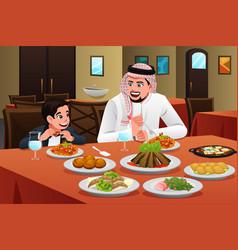 Muslim arabian man eating with his son vector