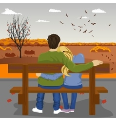 young couple sitting together on bench outdoors vector image