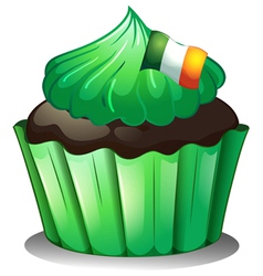 A green cupcake with the flag of Ireland vector image vector image