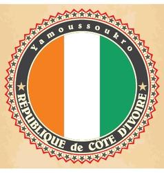 Vintage label cards ivory coast flag vector