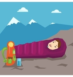 Woman resting in sleeping bag in the mountains vector