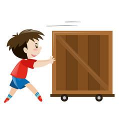 happy boy pushing wooden box vector image
