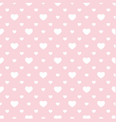seamless pattern with small hearts pink and white vector image