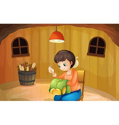 A woman sewing inside wooden house vector