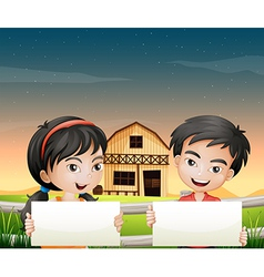 Two adorable kids with empty cardboards vector image vector image