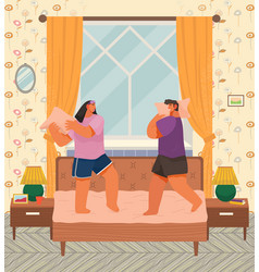 pillow fight couple in bedroom man and woman vector image