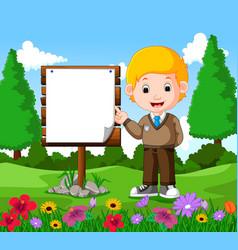 happy boy with empty signboard vector image vector image