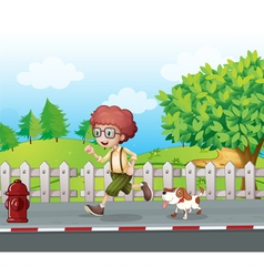A boy running along the road with his pet vector