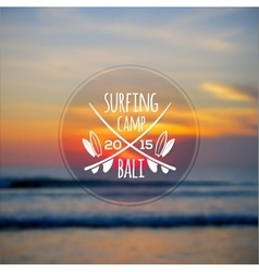 White surfing camp logo on blurred ocean sunset vector image