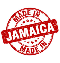 made in jamaica red grunge round stamp vector image vector image