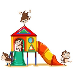 Monkeys playing at the playground vector image