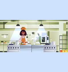 Female professional chef cook chopping vegetables vector