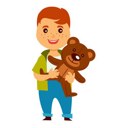 redhead boy with freckles holds soft teddy bear vector image